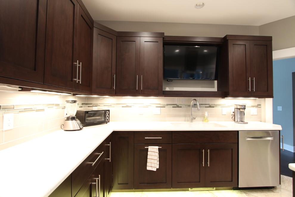 tv above kitchen sink flanked by dark