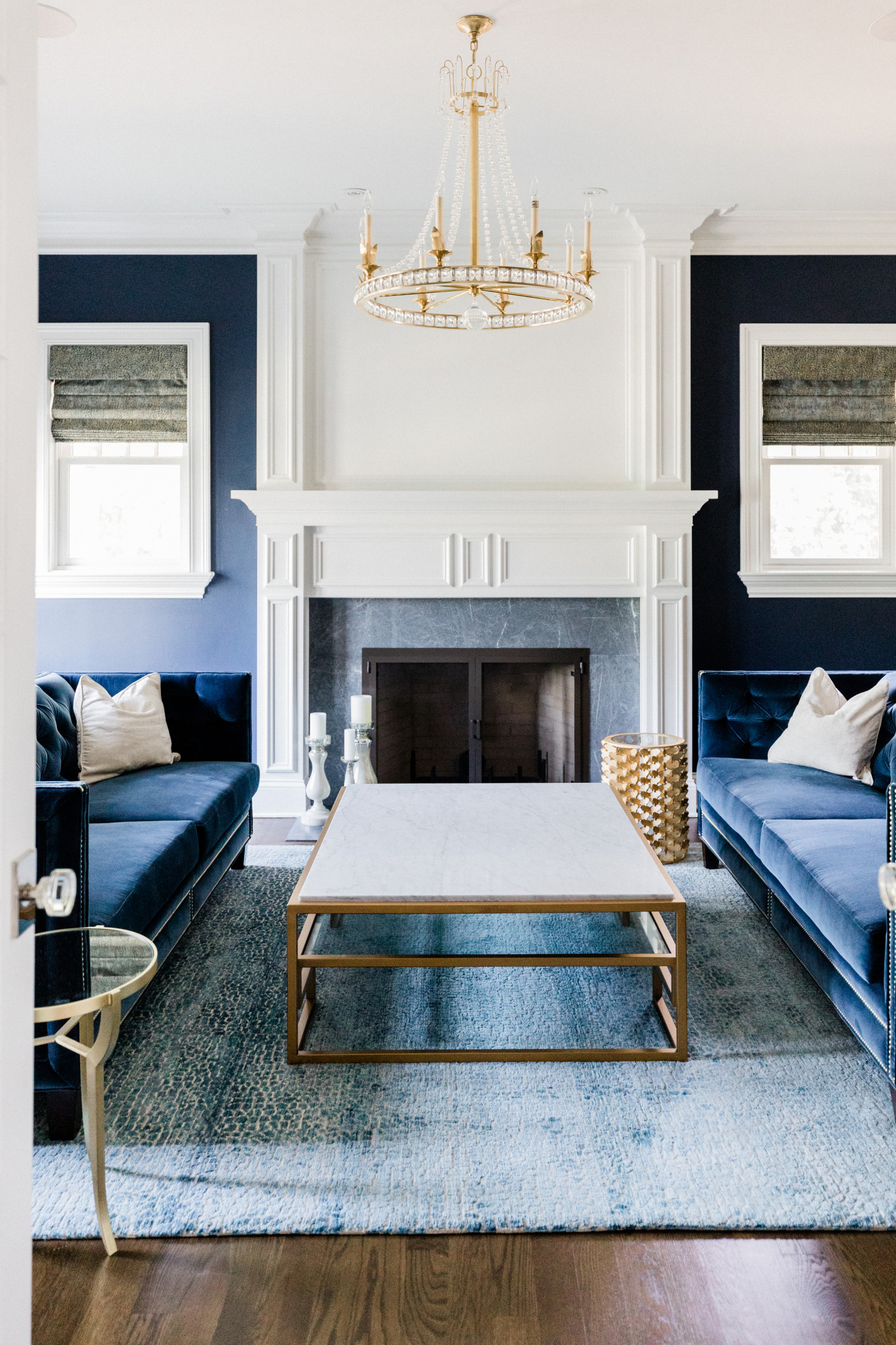 blue living room with a tile fireplace