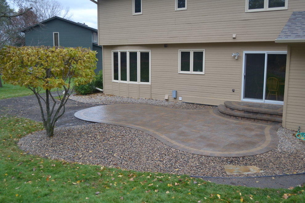 backyard paver patio and stoop