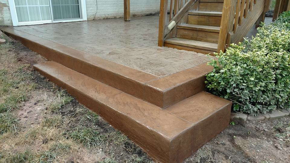 j stamped concrete patio with a step