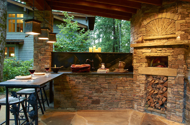 outdoor kitchen with wood burning pizza