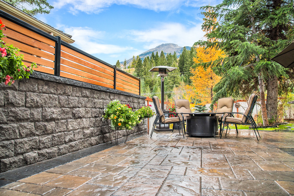 stone wall with privacy screen around