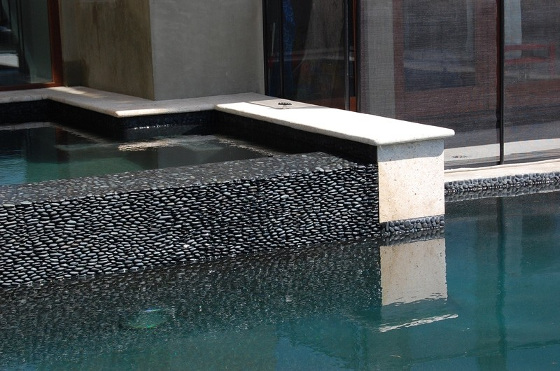 gray black standing pebble tile pool