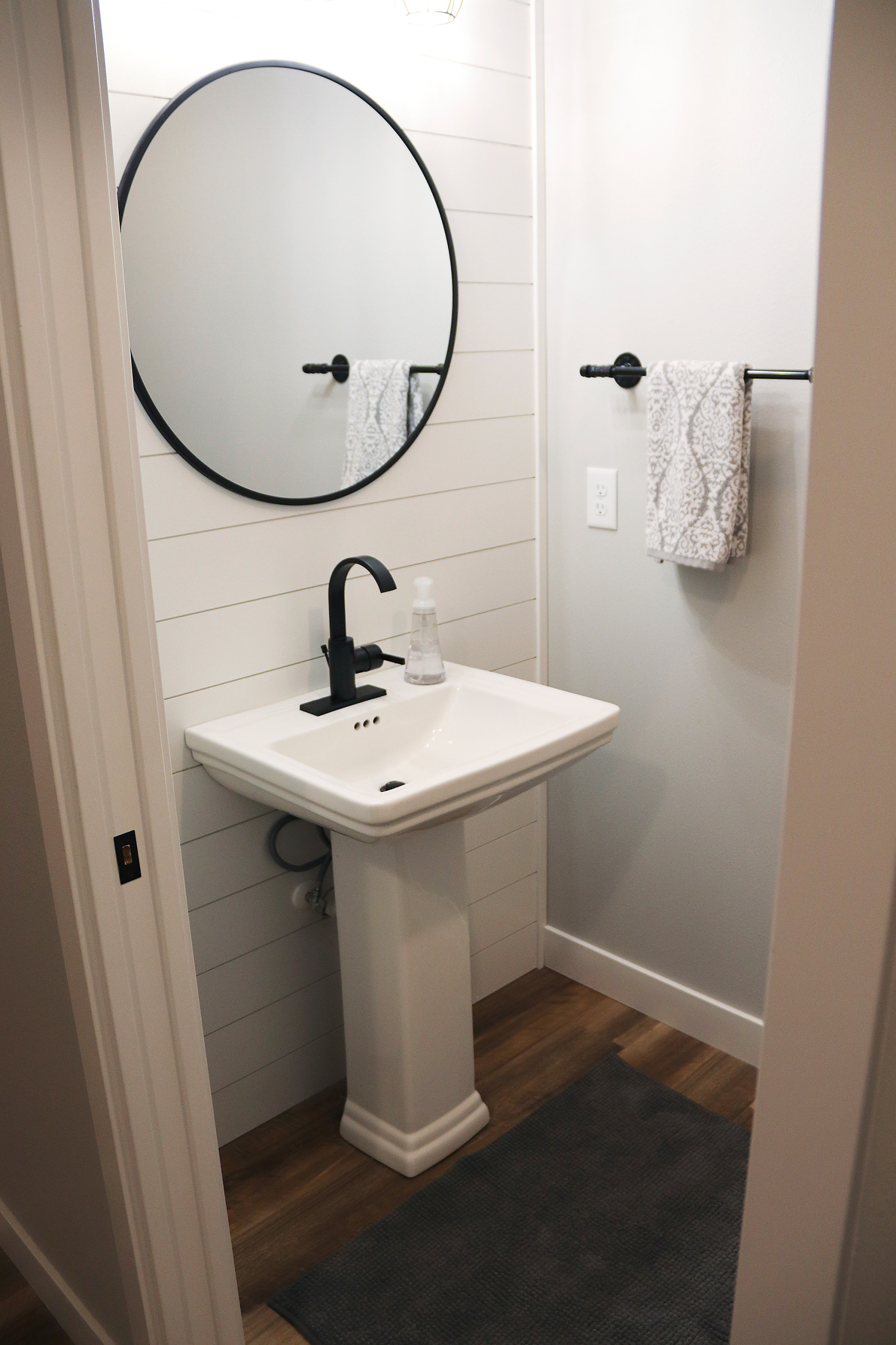 small powder room with a pedestal sink