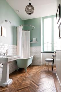 salle de bain avec un mur vert photos