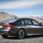2017 BMW M760i xDrive rear three quarter 06