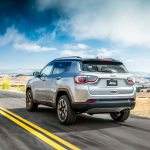 2017 Jeep Compass Limited rear three quarter in motion 02 1