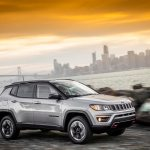 2017 Jeep Compass Trailhawk front three quarter in motion