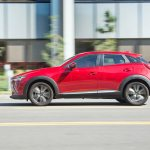 2016 Mazda CX 3 Grand Touring AWD side in motion 02