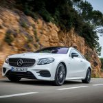 2018 Mercedes Benz E400 coupe front three quarter in motion 05 1