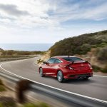 2017 Honda Civic Si Coupe rear three quarter in motion 1