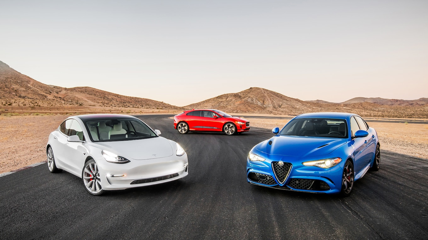 hight resolution of war of the worlds tesla model 3 dual motor performance vs jaguar i pace ev400 hse vs alfa romeo giulia quadrifoglio motor trend