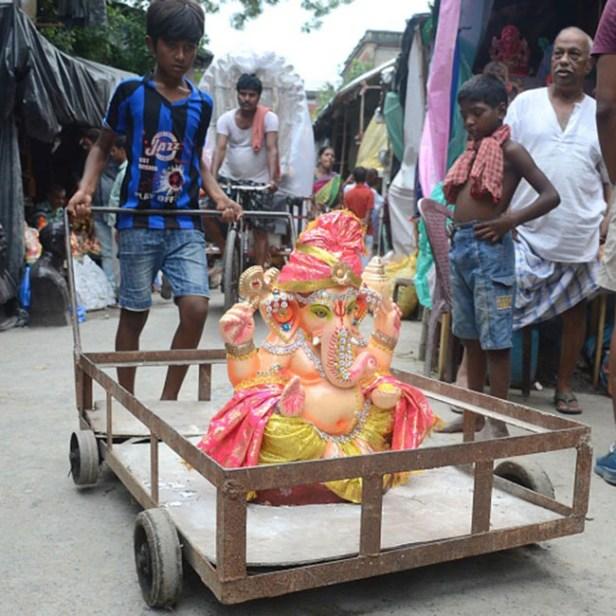 Lord Ganesha s idol on way to visarjan in Kolkata