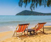Sun beach chairs near sea.  Stock Photo  alan64 #71406383