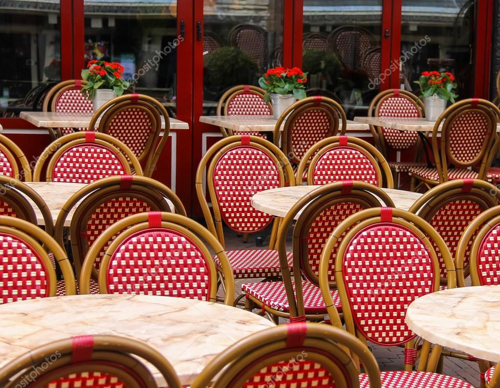 white wicker chairs and table how to tie a chair sash red small tables in outdoor street cafe stock photo