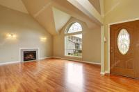 Empty living room with fireplace nd big arch window ...