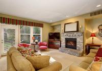 Cozy family living room with red chairs and fireplace ...