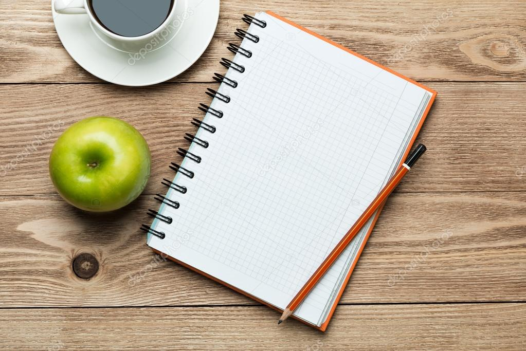 notepad with coffee apple
