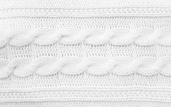Lace trims ribbon over white. Set of embroidered fabric