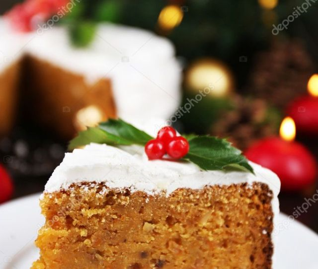 Slice Of Cake Covered Cream With Christmas Decoration On Wooden Table Background Stock Photo
