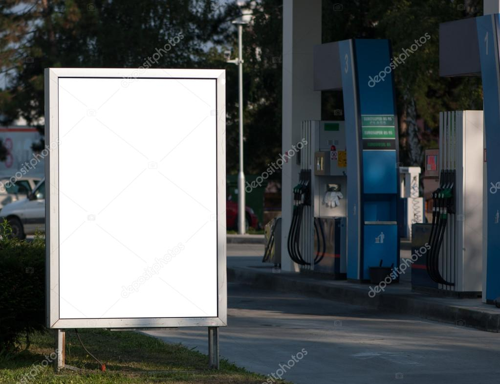 Stop and street side retail advertising signs (for example, cigarette advertising at gas stations). Billboard On Gas Station Stock Photo By C Pozitivo 55499525