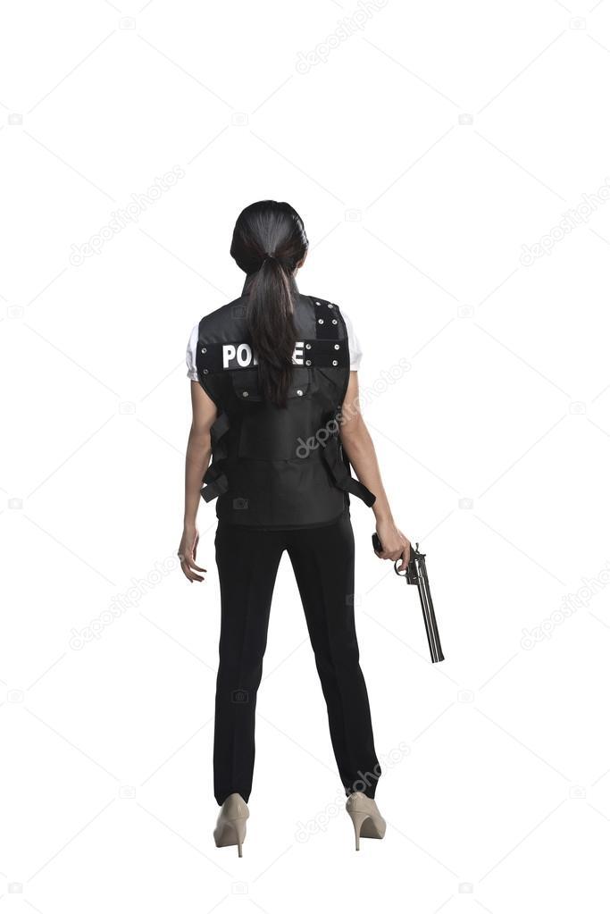 Back view of woman holding gun  Stock Photo  leolintang