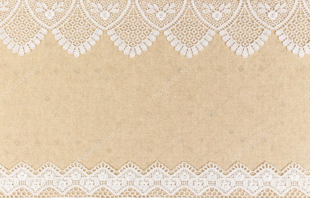 Texture de la toile de jute avec de la dentelle blanche