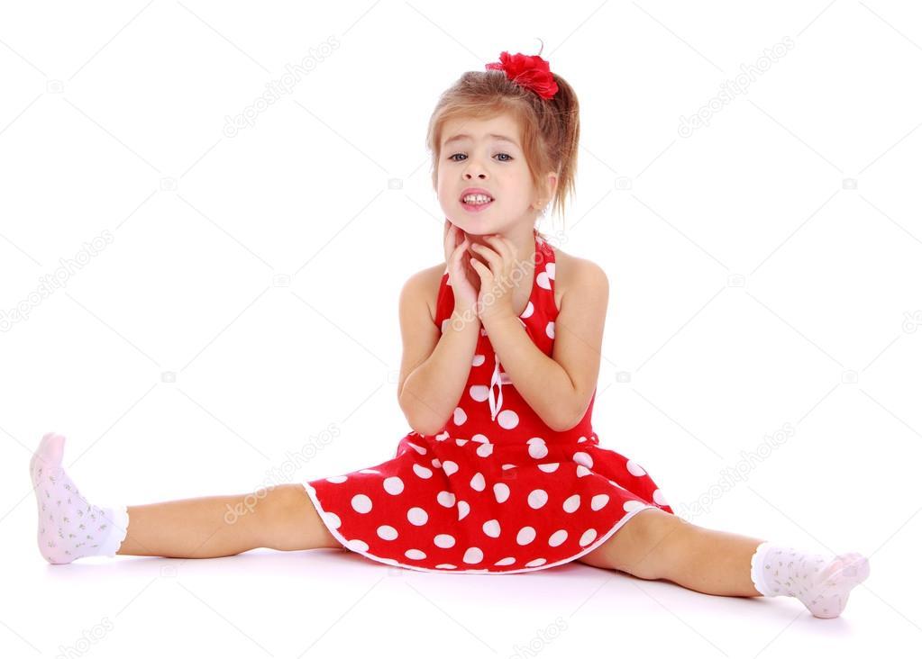 Beautiful little girl sitting legs spread wide  Stock