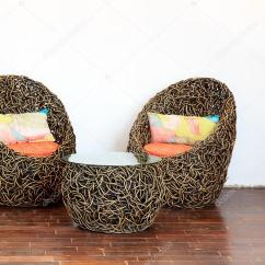 Round Wicker Chair Hospital Bed Chairs With Glass Table And Colorful Pillows Stock Photo