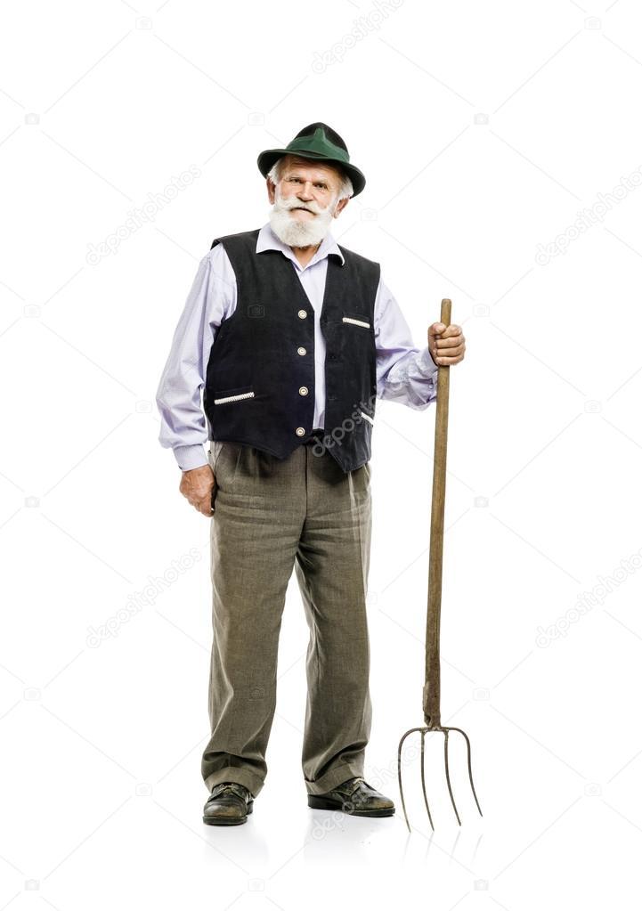 Bayern-Mann hält Mistgabel in der Hand — Stockfoto © halfpoint #56164749