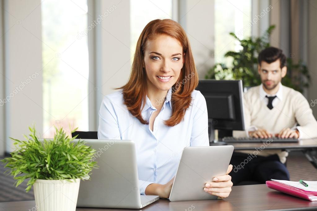 sales woman behind laptop