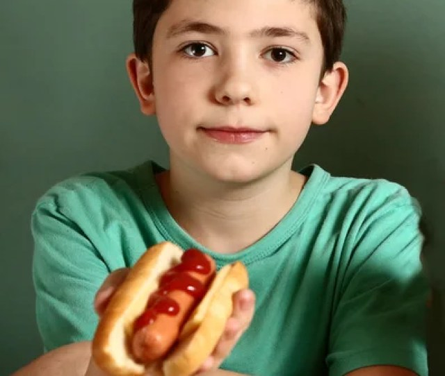Teen Handsome Boy With Hot Dog Stock Photo
