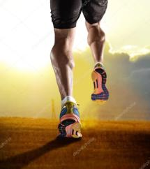 Close Feet With Running Shoes And Strong Athletic Legs