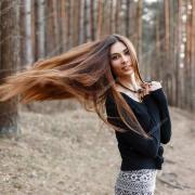 beautiful girl with long hair walking