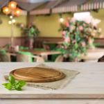 Round Board On Kitchen Table Over Cafe Interior Background Stock Photo C Didecs 56034971