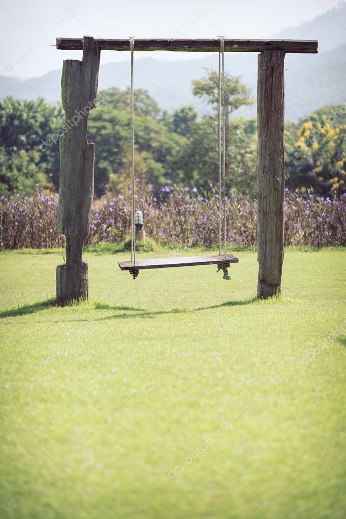 https sp depositphotos com 59196623 stock photo playground swing made wood hanging html