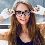 woman wearing clear hipster glasses