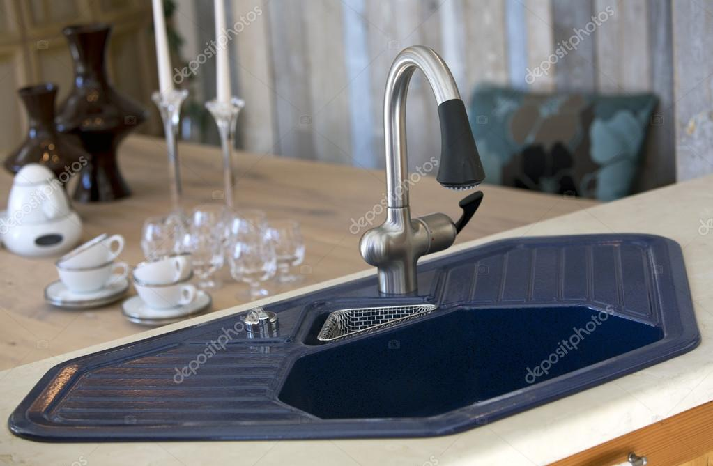 blue kitchen sink aid microwave and dining room table with dishes stock photo