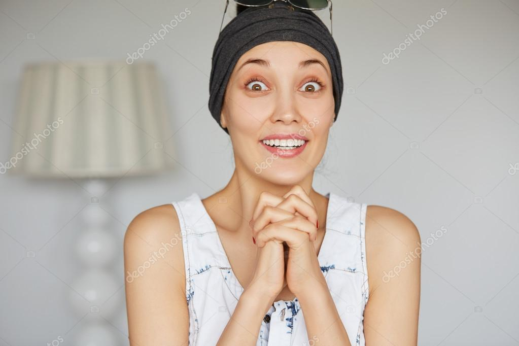 excited woman holding crossed