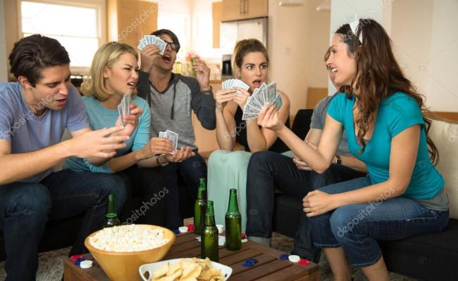 Attractive Group Of Friends At Home Game Night Party