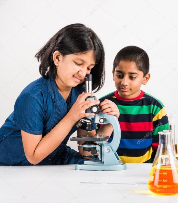 Indian Small Boy And Girl Science Experiment