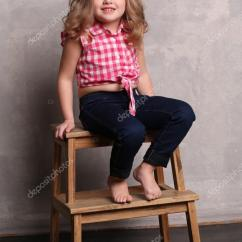 Little Girl Chairs Best Inversion Chair Sitting On A Gray Background Stock Photo