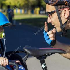The Bike Chair Dining Foam Replacement Father And Son Riding At Bicycle With Stock Photo