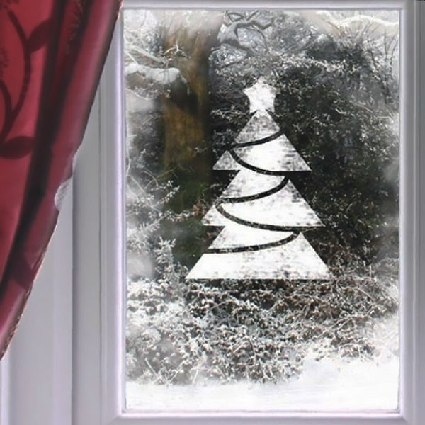 Figure Christmas tree with syrup and powdered sugar on the window to the new year photo