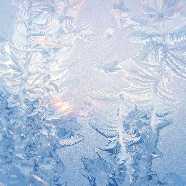 Frosty patterns on the window of water solution and photographic fixing photo