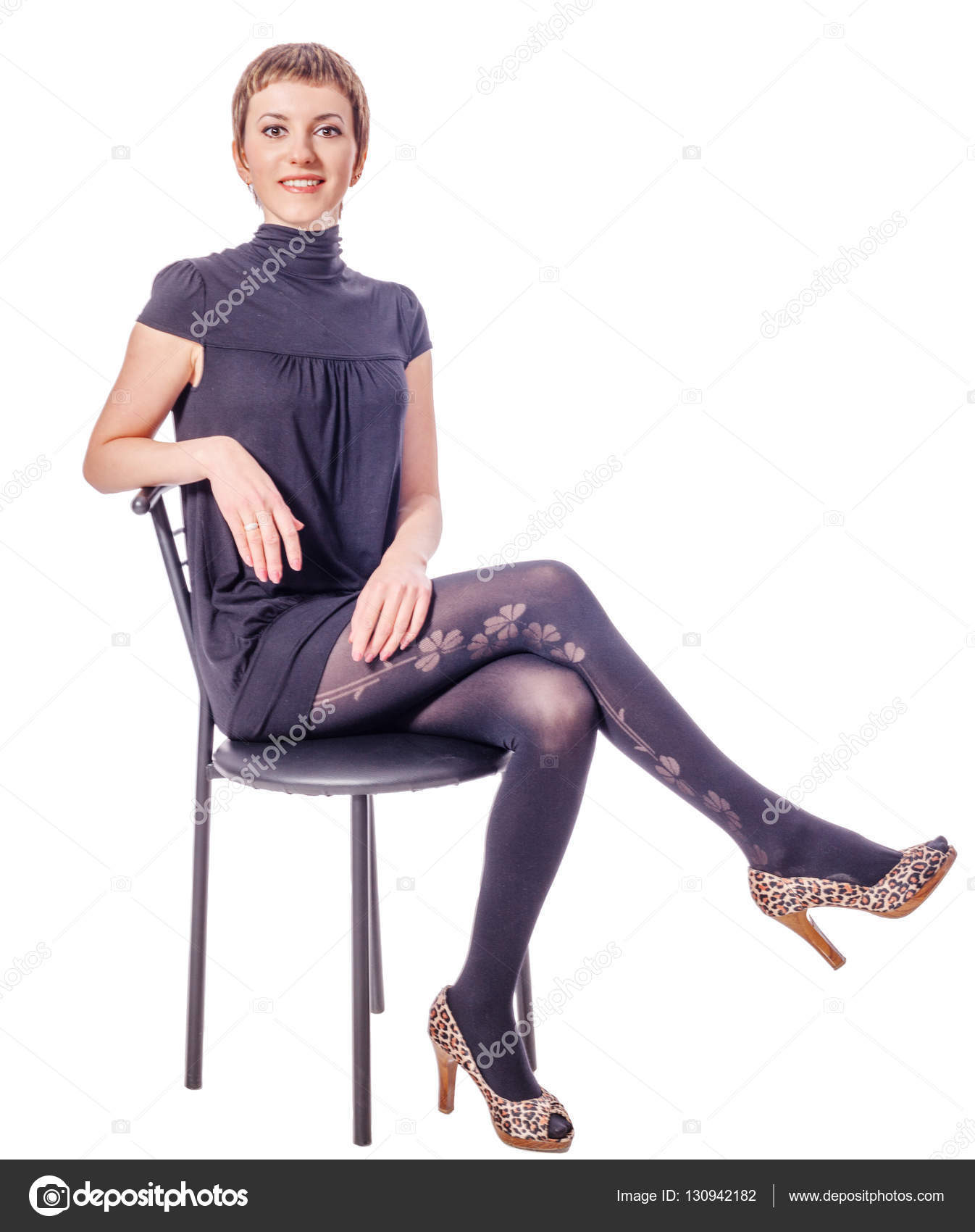 woman sitting in chair folding leather and wood rocking on  stock photo olgasweet 130942182