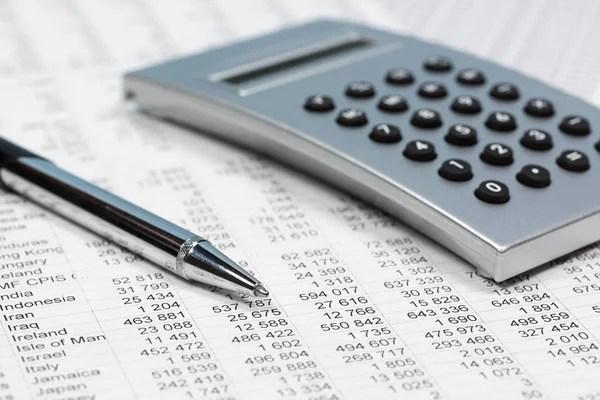 Financial accounting calculator on balance sheets — Stock Photo ...