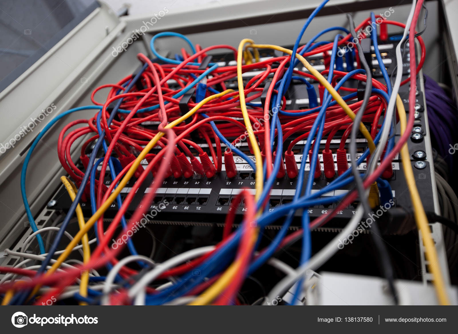 hight resolution of close up view of tangled wires in server room at television station photo by londondeposit