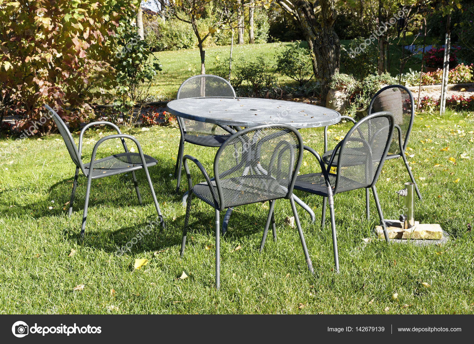 vintage wrought iron table and chairs for small balcony picnic in italian garden stock photo