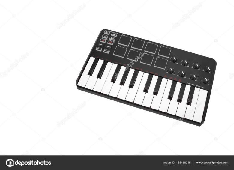 musical instrument - midi keyboard white background — stock photo